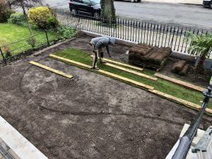 Laying turf grass, front garden - Northbrook Road