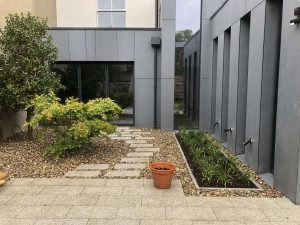 Finished backgarden patio with large pebbles - Northbrook Road